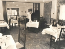 Restaurant Manager Re-Setting After Service